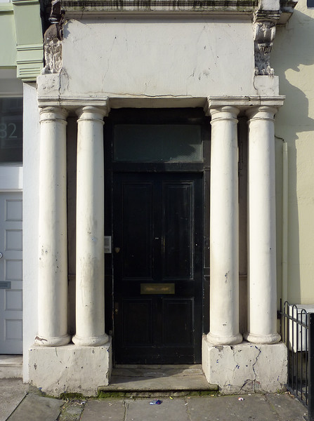 """280 Westbourne Park Road, Notting Hill, London. This is the blue door where William lives in the movie """"Nottin Hill"""". Please note, this door is actually located in Westbourne Park Road, that crosses Portobello Road. The blue door has been sold at an auction and now there is a black door."""