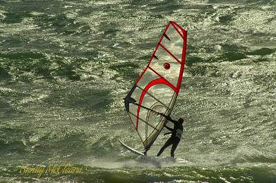 A windsurfer on Mounts Bay in Cornwall, England.