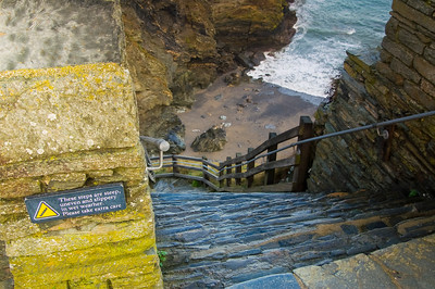 Steep stairs lead down towards the beach at Tintagel Castle in Cornwall.