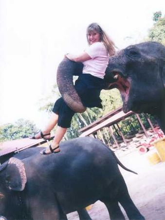 2001 - Pattaya, Thailand.  This beach community featured a wonderful botanical park and zoo.  Pam gets her first elephant  trunk ride.