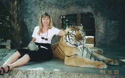 2001 - Pam's getting up close and personal with one of Thailand's bengal tigers.
