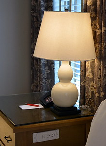 Nightstand, lamp, and ingenious outlet at the Taconic Hotel in Manchester, VT