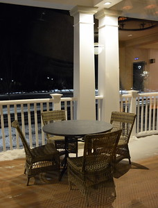 Table seating on the wraparound porch at the Taconic Hotel in Manchester, VT