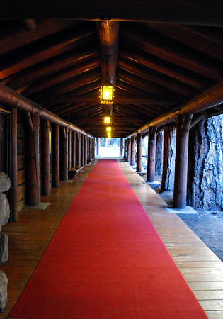 Red carpet walkway for guests leading from the porte-cochère to the main entrance.