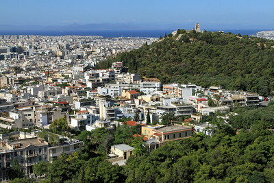 View over Athens with Filopappos Hill and the Monument of Phillopappus (on right).