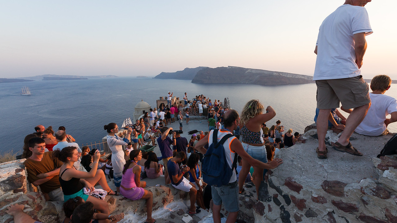 People gathering to view sunset in Oia, Santorini