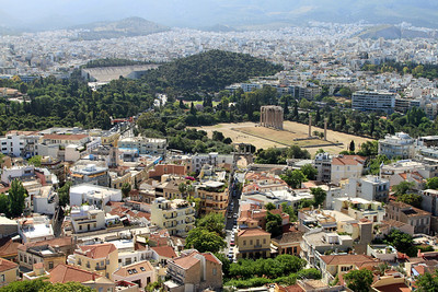 View from the Acropolis over the Temple of Olympian Zeus (columns in park) and Kallimarmaro Stadium (background hill), site of the first modern Olympic Games in 1896.