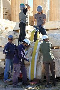Construction workers prepare to move a stone carving used in the reconstruction of the Parthenon.