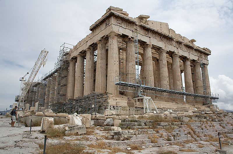 The Parthenon, still under renovation. The Parthenon's roof was blown off by a cannon shot by the Venetians while it was occupied by the Turks in 1687. The cannon shot ignited the gunpowder the Turks were storing in the Parthenon.
