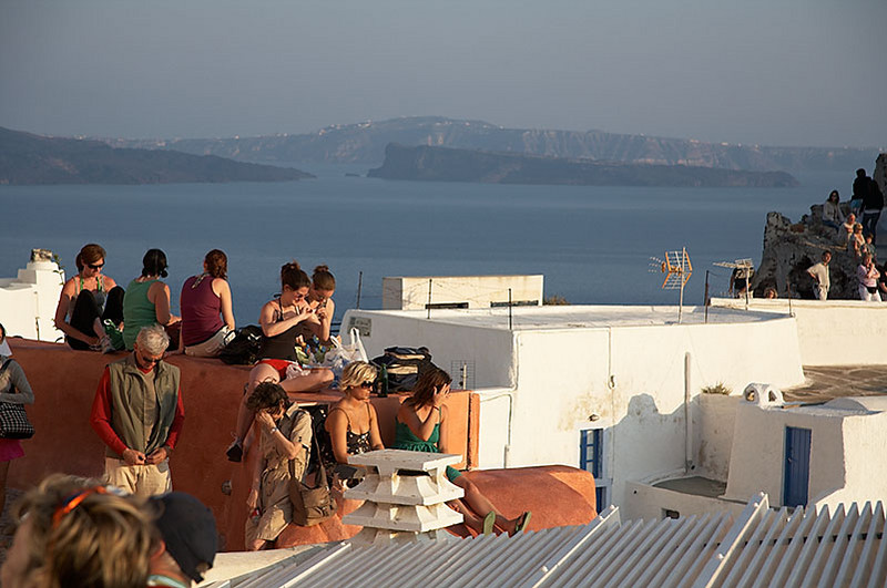 Some of the crowd gathering to watch the sunset at Ia, the most popular place to watch the setting sun on Santorini. Can you imagine how packed the rooftops and walkways will be during the peak season?