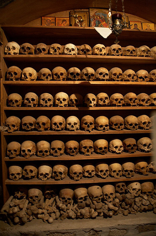 A shelf full of skulls in Moni Megalou Meteorou. We think these are skulls of past monks who lived at the monastery. There is a small hole in the door that lets you see the shelf.