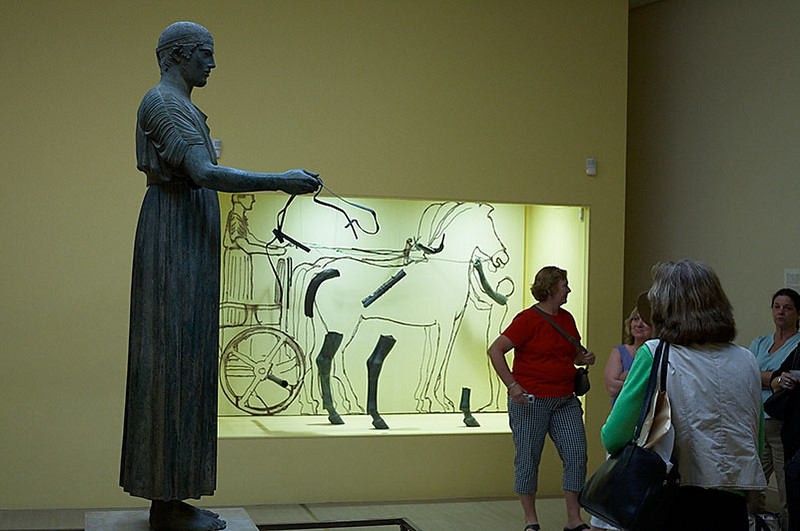 This chariot driver is the most treasured possession of the museum at Delphi. The display in the background shows what the entire sculpture used to look like. This chariot driver was smuggled out of Italy to England and bought back by Greece for $4 million dollars.