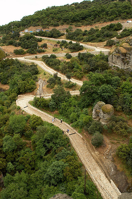 This is the winding path we walked to Moni Agias Triados. This is the famous monastery shown in <i>For Your Eyes Only</i> - one of the 007 series. Unfortunately, it was raining for most of the walk to this monastery, so we did not get a good shot of the monastery atop its rock formation. This monastery required the most climbing of the four we visited. Visitors basically have to begin their ascent at the very bottom of the rock formation.