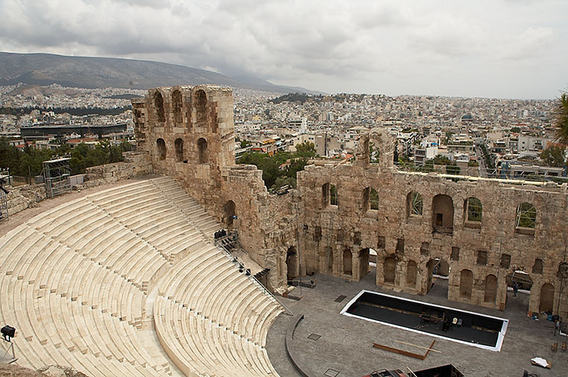 We woke up around noon after our first night in Athens. We took the metro to Monastiraki and hiked up the hill to the Acropolis. We bypassed Ancient Agora on the way and unfortunately, returned too late to see it.<br /> <br /> One of first things we saw  was the Odeon of Herodes Atticus. This theater is just outside the Acropolis walls and is still used for performances today.