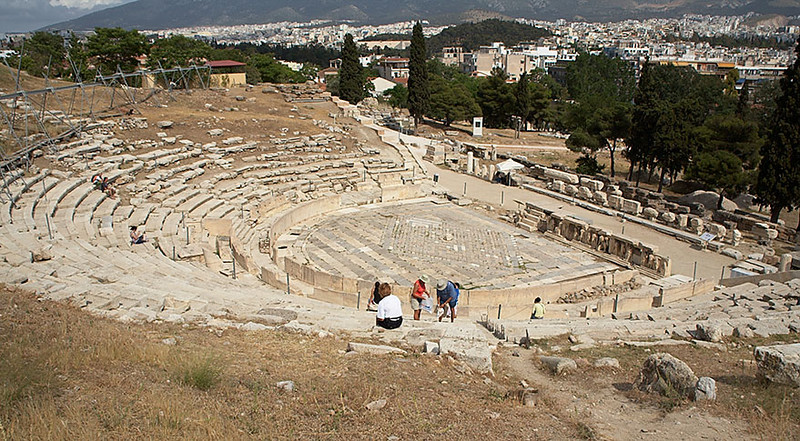The Theater of Dionysus. What remains is much smaller than its original size. This theater is outside the Acropolis on the southeastern side.
