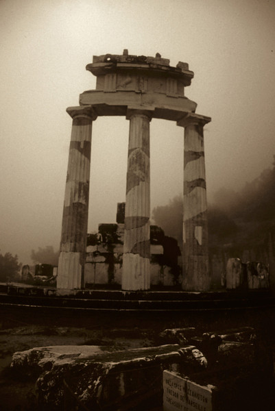 The Tholos at the sanctuary of Athena Pronaia (Delphi)<br /> It was a rainy day - with a fog creeping into the valley.