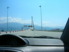 Greece - Rio-Andrio 4 span cable stayed bridge through the windshield.  11 Euros to drive across it.  Peleponnese mountains behind Patra in the distance.