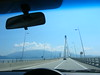 Greece - Rio-Andrio 4 span cable stayed bridge through the windshield.  11 Euros to drive across it.  Peleponnese mountains behind Patra in the distance