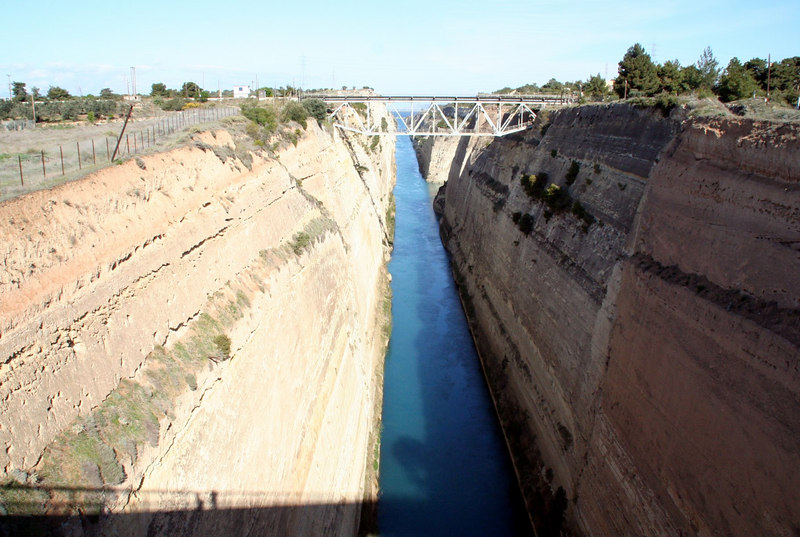 Korinthos Canal. This relatively short canal is cut out of solid rock and saves sailing all the way around the Peloponnese peninsula.