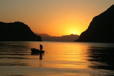 Fisherman at sunrise in Pethi Bay, Symi Island, Greece (Dodecanese Islands). My favorite place on our Turkey/Greece sail.