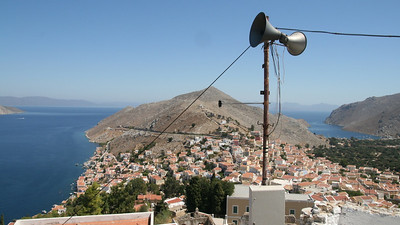 Speakerphones outside a hill-top church positioned to broadcast the Word to both sides of the island. Symi Island, Dodecanese, Greece.