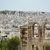 Ancient architectural features in forground of Athens urban landscape.