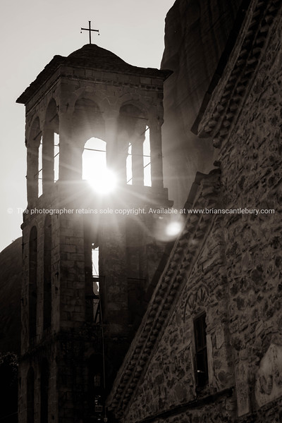 Bright light of sunflare through church bell tower