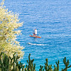 Paddle boarder and swimmer