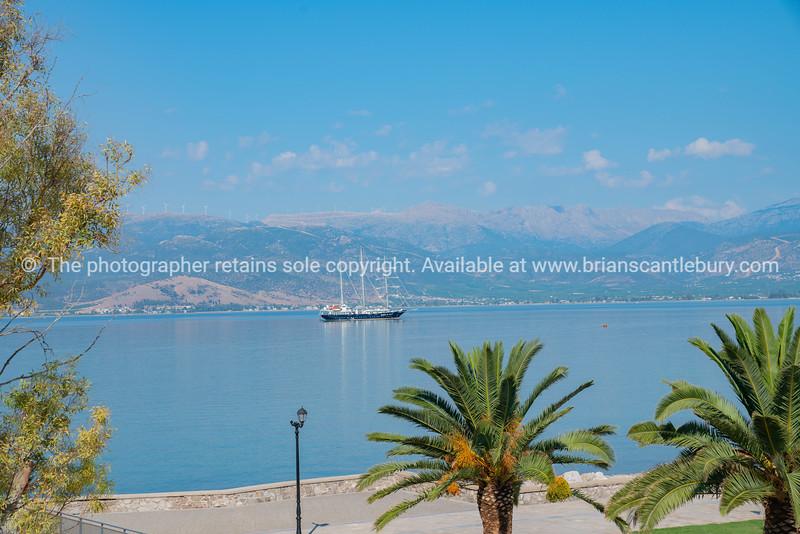Luxury yacht in distance in harbor off Geeek tourist destination of Nafplio.