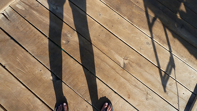 My feet on a dock.