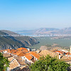 from Delphi, overlooking the towns roof-tops and down valley to part od Corinthian coast and little town Itea