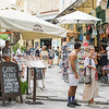 People wandering the streets, shopping and dining in Plaka district.