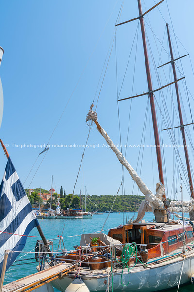 Classic old yacht with varnished wooden cabin and spars