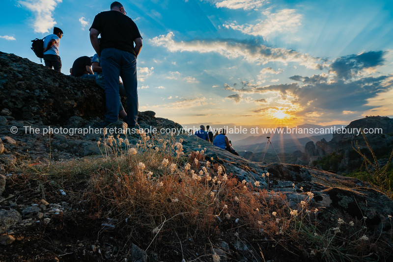 Silhouette of fo foreground hills and rocks of Meteora at sunset
