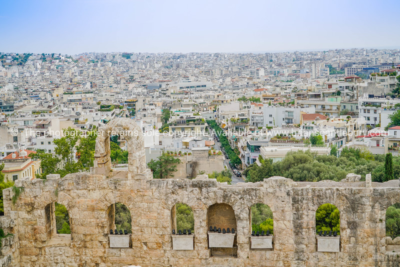Athens skyline beyond stone ancient structure