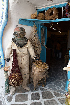 A natural sponge shop on Mykonos. Inside are photos of people actually using those old fashioned dive suits to collect sponges.