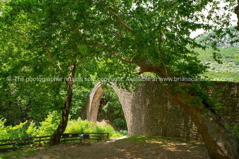 Historic stone arch bridge at Zagori in mountains in central Greece.