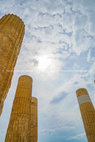 Doric pillars towering skyward above.