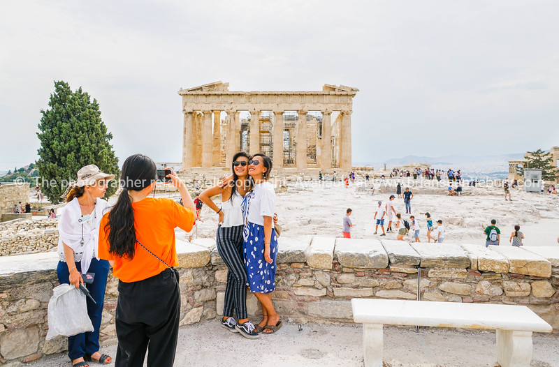 Tourists taking photographs in front of Parthenon on acropolis.