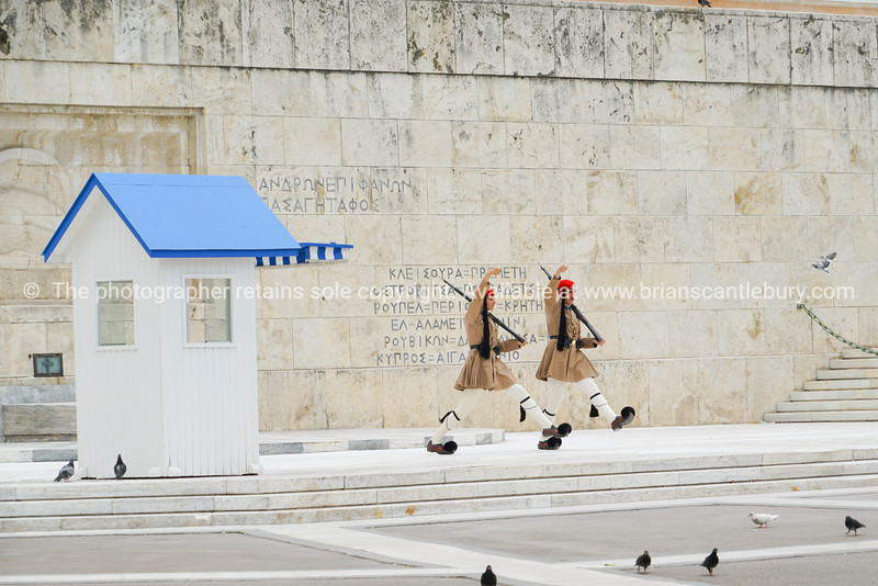 Presidential Guard outside Presidential Mansion and wall with greek character signs guards Tomb of Unknown Soldier.