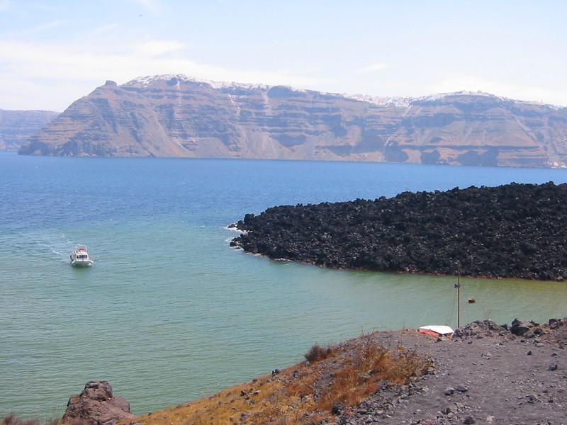 Nea Kameni (New 'Burnt'). The black rock-like soil is actually lava.