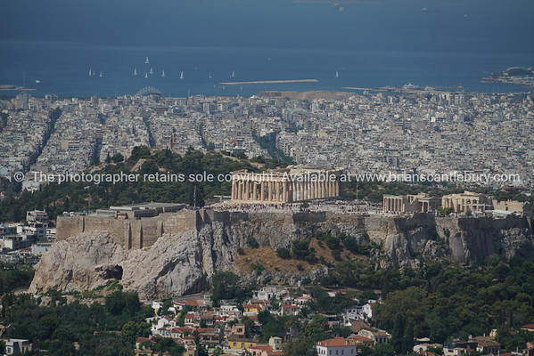 The Acropolis in centre of  urban Athens view from top Mount Lycabettus