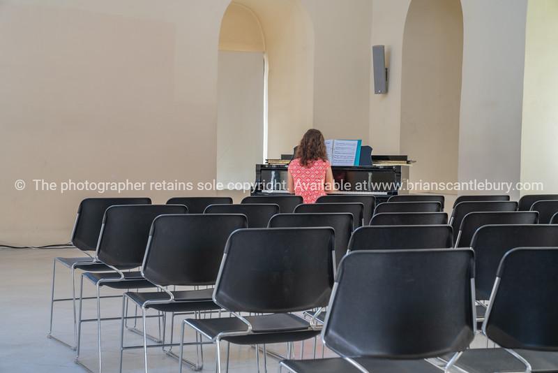 Pianist in empty Nafplio Town Hall