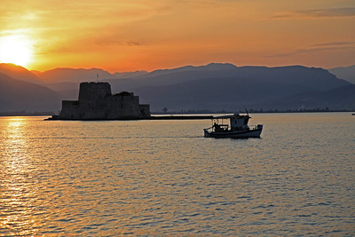 View of the The castle of Bourtzi in the middle of the harbor of Nafplion.  The Venetians completed its fortification in 1473 to protect the city from pirates and invaders from the sea.  Later was  transformed into residence of the executioners of convicts from the castle of Palamidi and now mostly a tourist attraction and hosting the occasional summer  music festival.