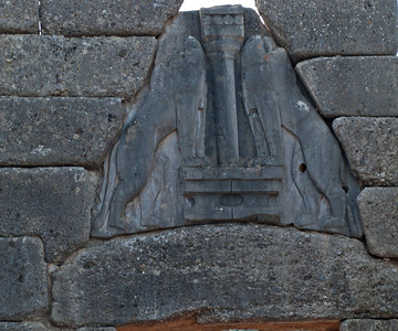 Detail of the frieze above the lintel of the Lion Gate of Mycenae--at entrance of the city.  The gate was erected in c. 1250 BCE.  The walkway to the gate, about 15 m long and 7 m wide, is flanked by high walls which would have allowed the defenders ample opportunity to hurl missiles at anyone approaching the gateway.  It is the oldest example of monumental sculpture in Europe