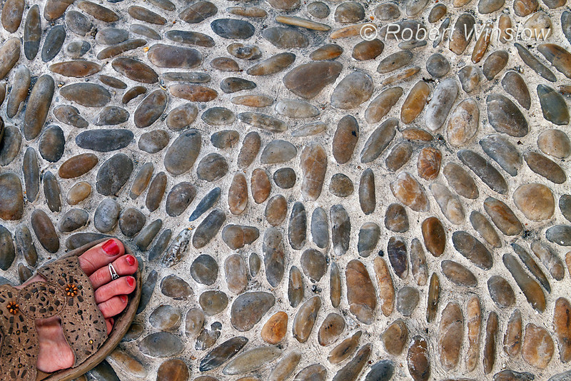 Model Released, Woman's foot on Pavement, Island of Mykonos, Cyclade Islands, Aegean Sea, Greece