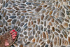 Model Released, Woman's foot on Pavement, Island of Mykonos, Cyclade Islands, Aegean Sea, Greece