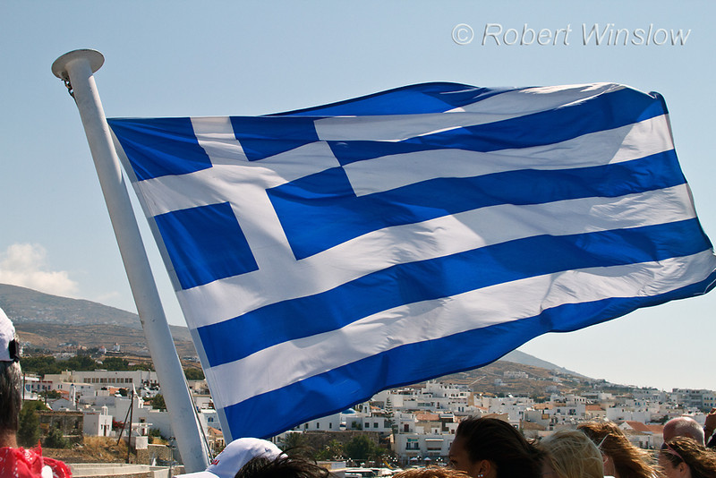 Greek Flag Flying on Ferry, Island of Tinos in Background, Cyclade Islands, Aegean Sear, Greece