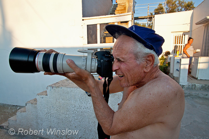 Man with Camera, Galissas, Island of Syros, Cyclade Islands, Aegean Sea, Greece