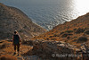 Model Released, Female Hiker headed down to Cave of Saint Sefanos, Galassis, Island of Syros, Aegean Sea, Cyclade Islands, Greece